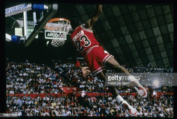 Michael Jordan of the Chicago Bulls goes for the slam dunk during a circa 1987 NBA basketball game. Jordan played for the Bulss from 1984-93 and 1995...