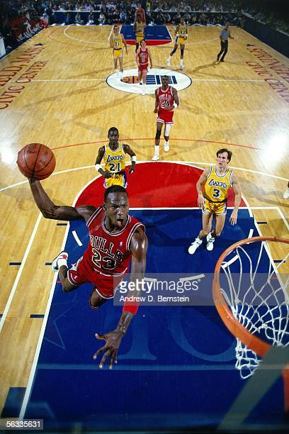 Michael Jordan of the Chicago Bulls goes in for a dunk against the Los Angeles Lakers circa 1988 at the Springfield Civic Center in Springfield...