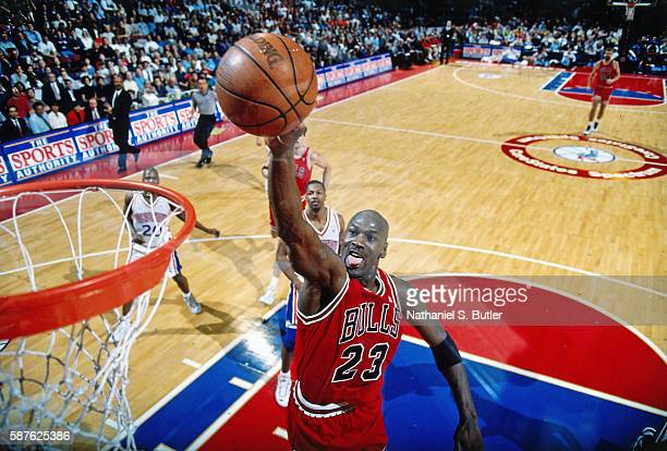 Michael Jordan of the Chicago Bulls goes up for a dunk against the Philadelphia 76ers on March 18 1996 at the CoreStates Spectrum in Philadelphia...