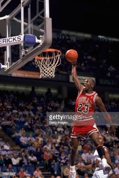 Michael Jordan Of The Chicago Bulls Goes Up For A Dunk During An NBA Game Against