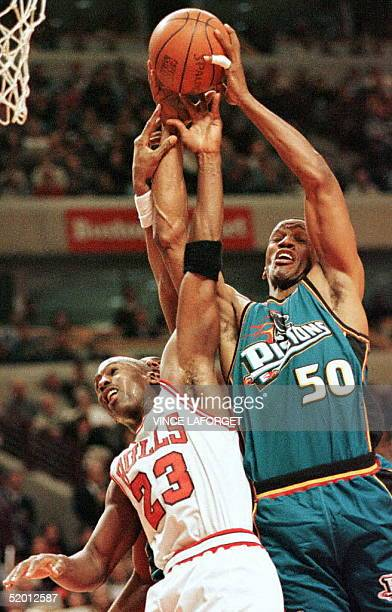 Michael Jordan of the Chicago Bulls goes up for a rebound against Detroit Pistons forward Otis Thorpe in the fourth quarter of their 22 March game in...