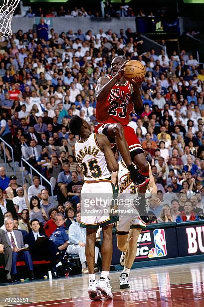 Michael Jordan of the Chicago Bulls goes up for a shot against David Wingate of the Seattle SuperSonics in Game Five of the 1996 NBA Finals at Key...