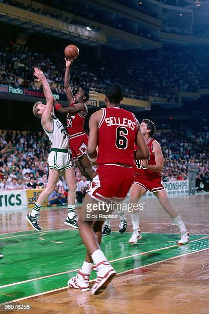 Michael Jordan of the Chicago Bulls goes up for a shot against Larry Bird of the Boston Celtics during a game played in 1987 at the Boston Garden in...