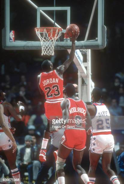 Michael Jordan of the Chicago Bulls goes up for a slam dunk against the Washington Bullets during an NBA basketball game circa 1985 at the Capital...