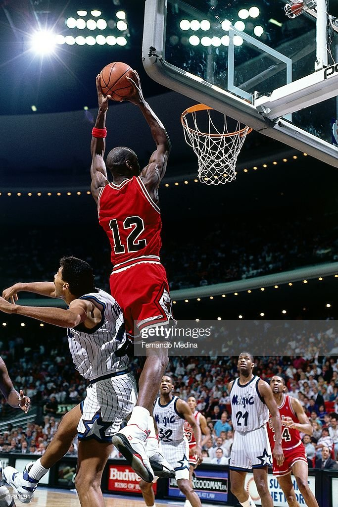Michael Jordan Of The Chicago Bulls Goes Up For A Slam Dunk Wearing Jersey 12