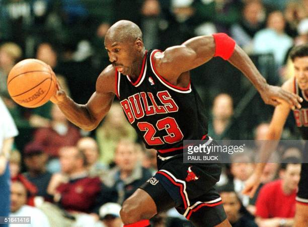 Michael Jordan of the Chicago Bulls grabs a defensive rebound and sprints for the basket 12 March during first half action against the Dallas...