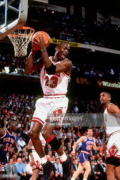 Michael Jordan of the Chicago Bulls grabs a rebound against the New York Knicks during an NBA game at Chicago Stadium in Chicago Illinois in 1991...