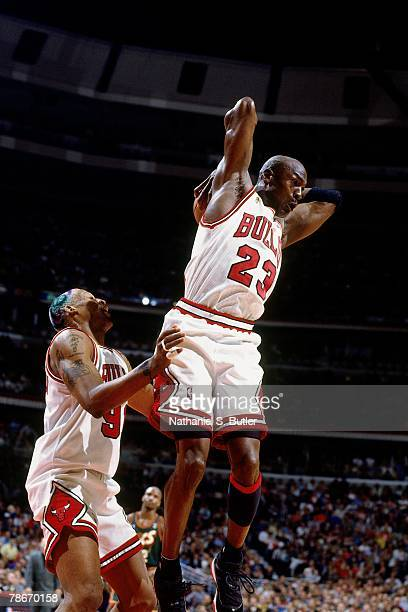 Michael Jordan of the Chicago Bulls grabs a rebound against the Seattle SuperSonics during Game Two of the 1996 NBA Finals at the United Center on...