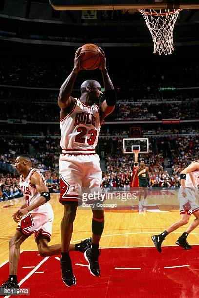 Michael Jordan of the Chicago Bulls grabs a rebound in Game Six of the 1996 NBA Finals against the Seattle SuperSonics at the United Center on June...