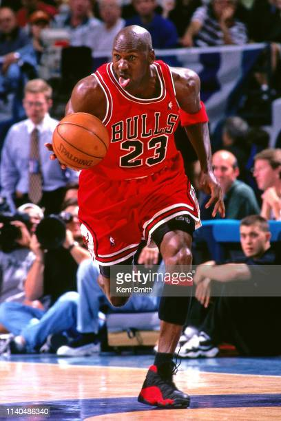 Michael Jordan of the Chicago Bulls handles the ball against the Charlotte Hornets on May 8 1998 at Charlotte Coliseum in Charlotte North Carolina...