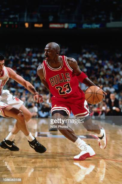 Michael Jordan of the Chicago Bulls handles the ball during the game against the Miami Heat on November 6 1996 at the Miami Arena in Miami FL NOTE TO...