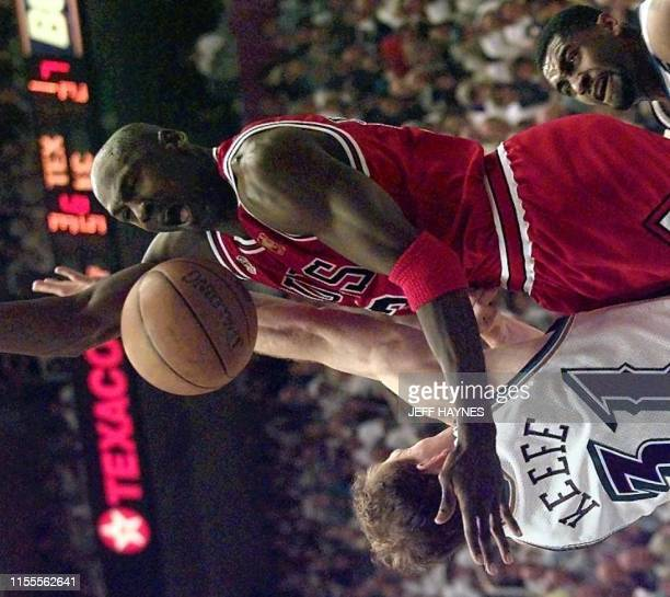 Michael Jordan of the Chicago Bulls has a shot blocked by Adam Keefe of the Utah Jazz 06 June during game three of the NBA Finals against the Jazz at...
