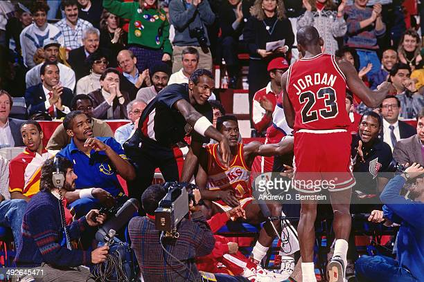 Michael Jordan of the Chicago Bulls high fives Clyde Drexler of the Portland Trail Blazers during the 1988 Slam Dunk Contest as part of AllStar...