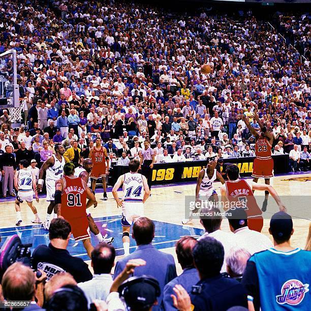 Michael Jordan of the Chicago Bulls hits the game winning shot against the Utah Jazz during Game Six of the 1998 NBA Finals played June 14, 1998 at...