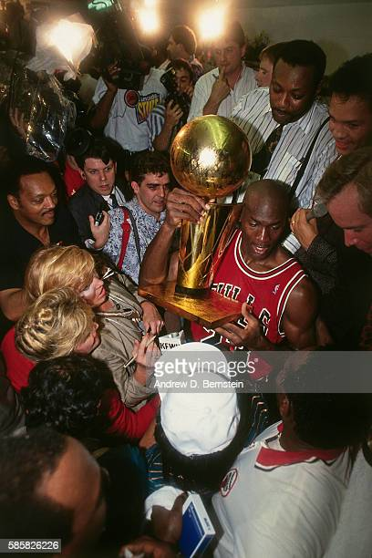 Michael Jordan of the Chicago Bulls holds up the Larry O'Brien Trophy after defeating the Los Angeles Lakers in Game Five of the NBA Finals on June...