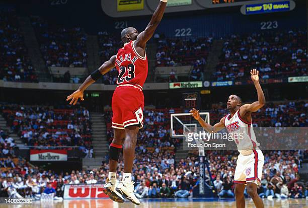Michael Jordan of the Chicago Bulls in action guarded by Kenny Anderson of the New Jersey Nets during an NBA basketball game circa 1993 at the Izod...