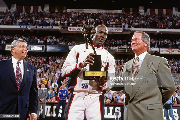 Michael Jordan of the Chicago Bulls is awarded the 1992 MVP trophy circa 1992 at Chicago Stadium in Chicago Illinois NOTE TO USER User expressly...