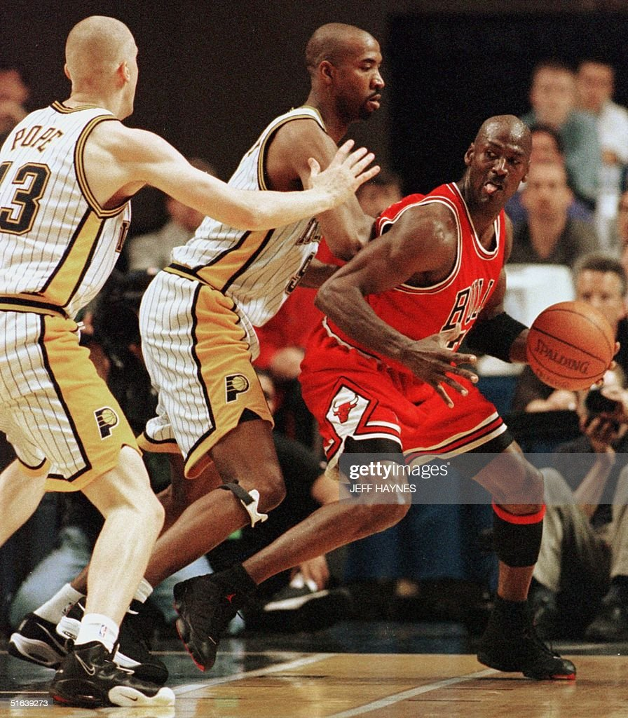 Michael Jordan (R) of the Chicago Bulls is guarded Pictures | Getty Images