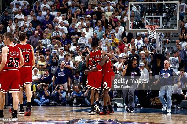Michael Jordan of the Chicago Bulls is helped off the court by Scottie Pippen during Game Five of the 1997 NBA Finals played against the Utah Jazz on...