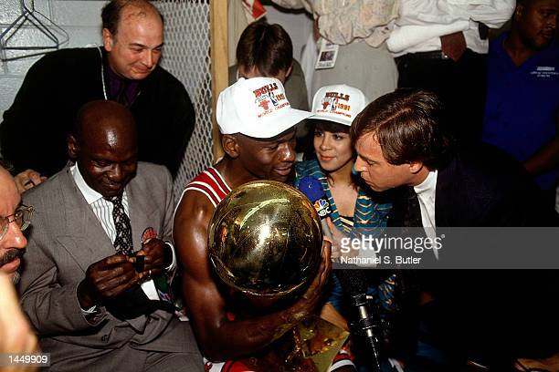 Michael Jordan of the Chicago Bulls is interviewed by Bob Costas after winning the 1991 NBA Championship against the Los Angeles Lakers in Los...