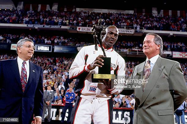 Michael Jordan of the Chicago Bulls is presented receives the 1992 MVP Trophy award given by NBA Commissioner David Stern prior to a game played in...