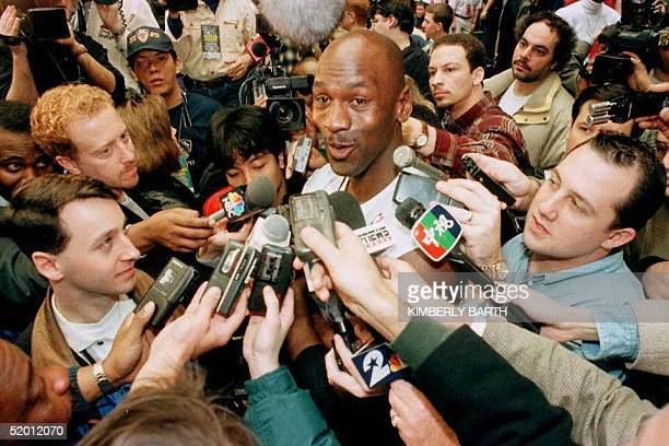 Michael Jordan of the Chicago Bulls is surrounded by the media 08 February before the Eastern Conference practice for the NBA AllStar Game at the...