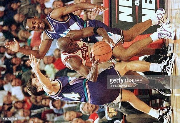 Michael Jordan of the Chicago Bulls is trapped by John Hornacek and Howard Eisley of the Utah Jazz 04 June during the second half of game two of the...