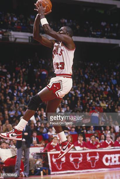 Michael Jordan of the Chicago Bulls jumps to shoot a basket at the Chicago Center in Chicago, Illinois.