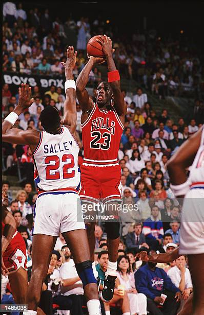 Michael Jordan of the Chicago Bulls jumps to shoot the ball as he is blocked by John Salley of the Detroit Pistons NOTE TO USER It is expressly...
