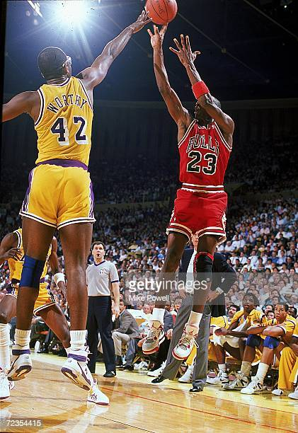 Michael Jordan of the Chicago Bulls jumps to shoot the ball during the game against the Los Angeles Lakers Mandatory Credit Mike Powell /Allsport