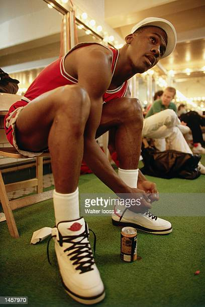 Michael Jordan of the Chicago Bulls laces up his sneakers prior to playing an NBA game in1987 NOTE TO USER User expressly acknowledges and agrees...