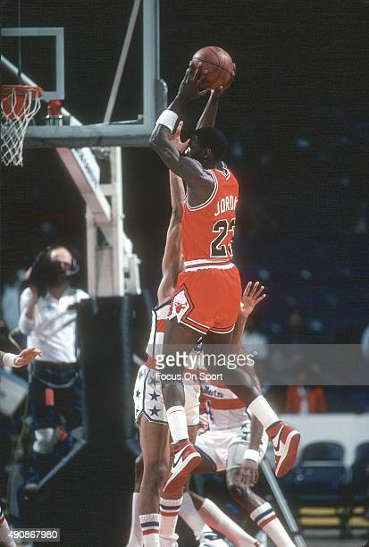 Michael Jordan of the Chicago Bulls leaps in the air and looks to pass against the Washington Bullets during an NBA basketball game circa 1991 at the...