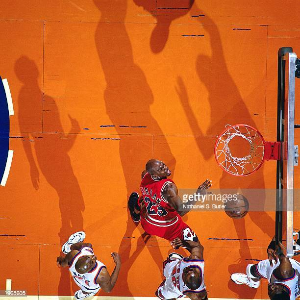Michael Jordan of the Chicago Bulls looks for a rebound against the New York Knicks in Game four of the Eastern Conference Semifinals during the 1996...