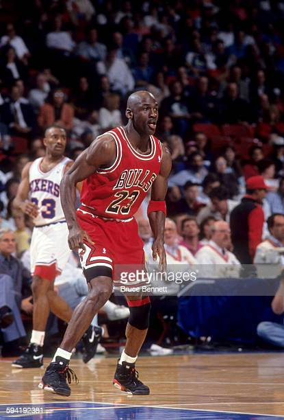 Michael Jordan of the Chicago Bulls looks for the pass during a game in the 1991 Eastern Conference Semifinals against the Philadelphia 76ers in May...