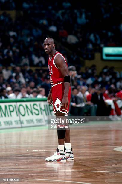 Michael Jordan of the Chicago Bulls looks on against the Boston Celtics during a game played at the Boston Garden in Boston Massachusetts circa 1993...