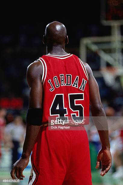 Michael Jordan of the Chicago Bulls looks on against the Boston Celtics during a game played in 1995 at the Boston Garden in Boston Massachusetts...