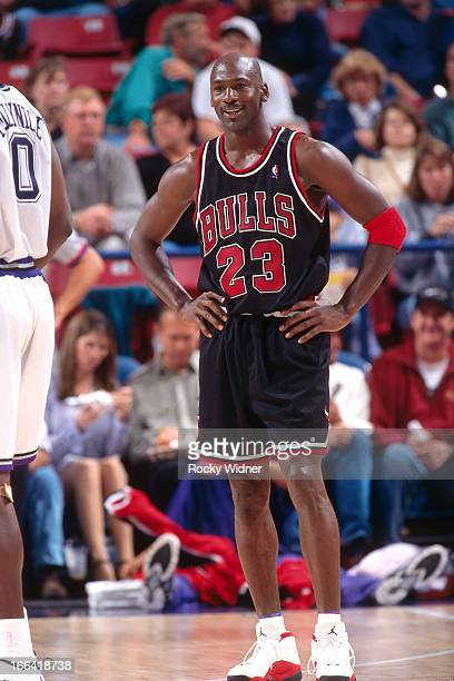 Michael Jordan of the Chicago Bulls looks on against the Sacramento Kings on November 23 1997 at Arco Arena in Sacramento California NOTE TO USER...