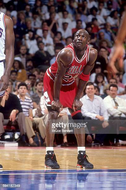 Michael Jordan of the Chicago Bulls looks on as the Philadelphia 76ers shoot free throws during a game in the 1991 Eastern Conference Semifinals in...