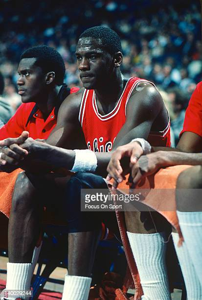 Michael Jordan of the Chicago Bulls looks on from the bench against the Washington Bullets during an NBA basketball game circa 1985 at the Capital...