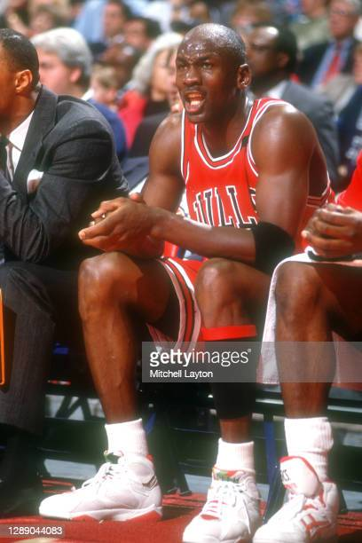 Michael Jordan of the Chicago Bulls looks on from the bench during a NBA basketball game against the Washington Bullets at Capital Centre on December...