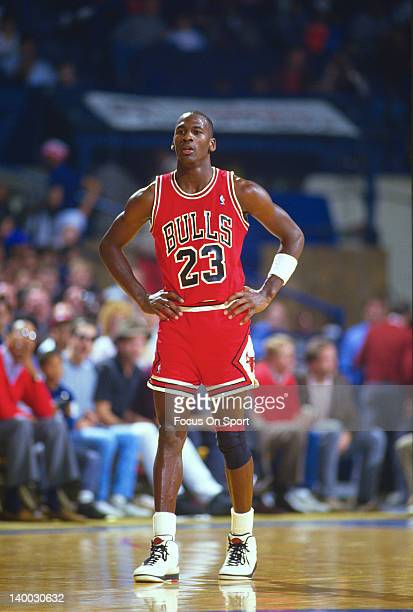 Michael Jordan of the Chicago Bulls looks on walking up the court against the Washington Bullets during an NBA basketball game circa 1986 at the...