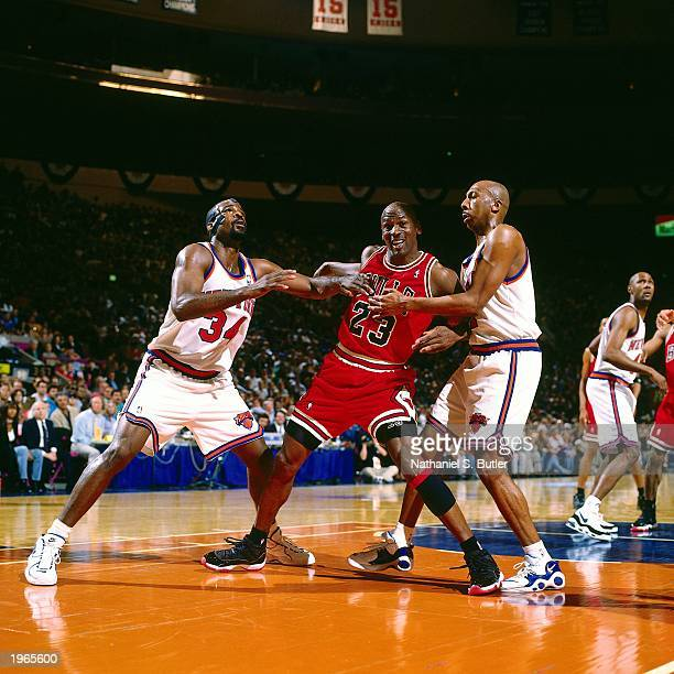 Michael Jordan of the Chicago Bulls looks to get by two defenders against the New York Knicks in Game four of the Eastern Conference Semifinals...