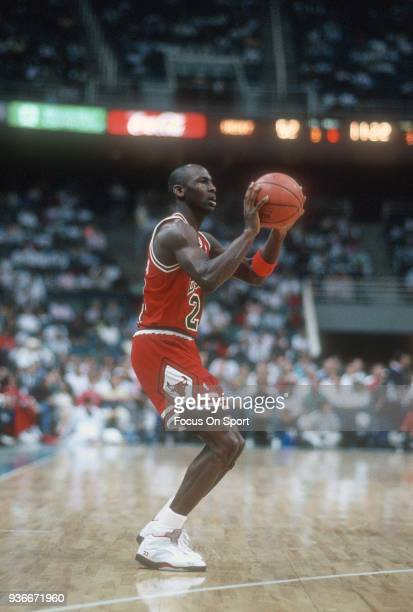 Michael Jordan of the Chicago Bulls looks to shoot against the Miami Heat during an NBA basketball game circa 1988 at the Miami Arena in Miami...
