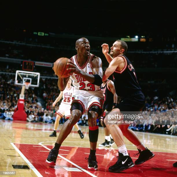 Michael Jordan of the Chicago Bulls looks to shoot the ball against the Miami Heat in Game one of the Eastern Conference Finals during the 1997 NBA...