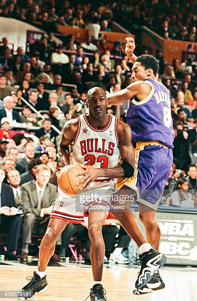Michael Jordan of the Chicago Bulls moves the ball against Kobe Bryant of the Los Angeles Lakers during the 1998 NBA AllStar game on February 8 1998...