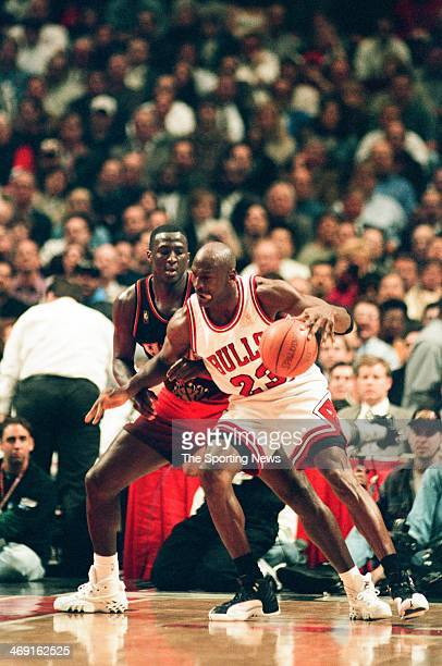 Michael Jordan of the Chicago Bulls moves the ball against Tyrone Corbin of the Atlanta Hawks during the game on May 13, 1997 at The Omni Coliseum in...