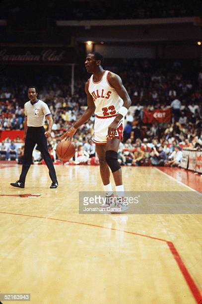 Michael Jordan of the Chicago Bulls moves the ball at the parameter during an Eastern Conference First Round Playoff game April 1985 game at the...