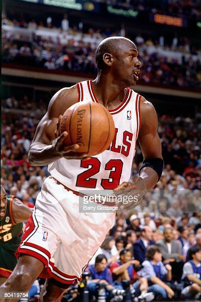 Michael Jordan of the Chicago Bulls moves the ball up court during Game Six of the 1996 NBA Finals against the Seattle SuperSonics at the United...
