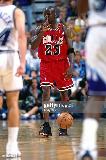 Michael Jordan of the Chicago Bulls moves the ball up court during Game Two of the 1998 NBA Finals against the Utah Jazz at the Delta Center June 5...