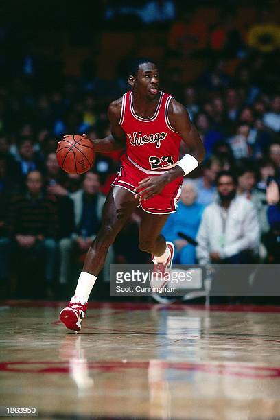 Michael Jordan of the Chicago Bulls moves the ball upcourt during a 1985 season NBA game. NOTE TO USER: User expressly acknowledges and agrees that,...